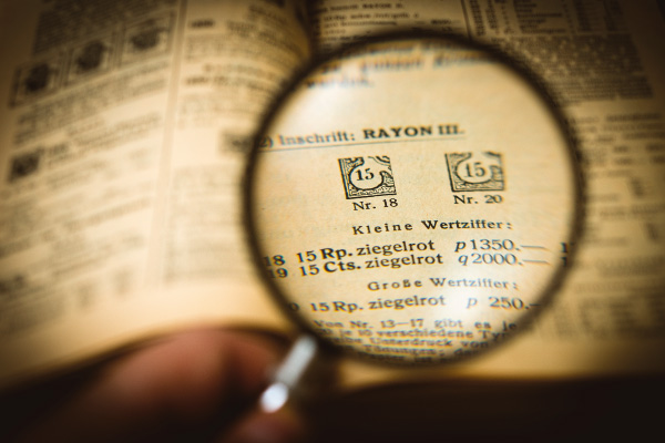 Looking at a book through magnifying glass