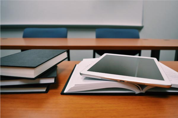Tablet in classroom where individual is undertaking blended learning