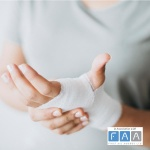 Person with palm of hand bandaged